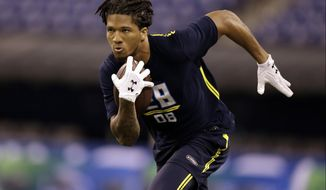 FILE - In this March 6, 2017, file photo, Washington defensive back Sidney Jones runs during the NFL football scouting combine in Indianapolis. Jones, a potential first-round draft pick, injured his left leg during defensive back drills in pro day workouts at the University of Washington on Saturday, March 11, 2017. (AP Photo/Michael Conroy, File)