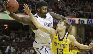 Akron's Isaiah Johnson, left, grabs a rebound ahead of Kent State's Mitch Peterson during the first half of an NCAA college basketball championship game of the Mid-American Conference tournament, Saturday, March 11, 2017, in Cleveland. (AP Photo/Tony Dejak)