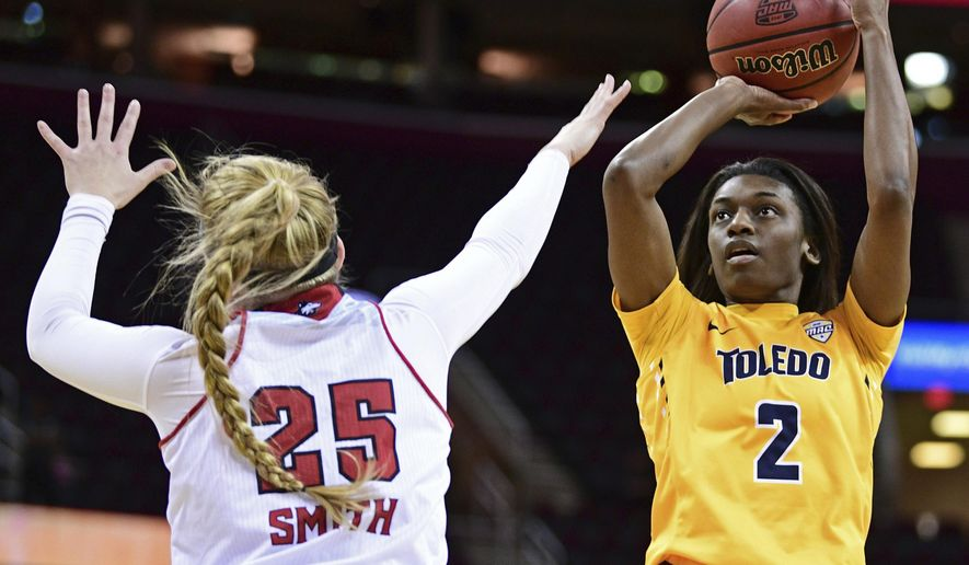 Toledo Rockets guard Mikaela Boyd (2) shots over Northern Illinois forward Kelly Smith (25) during the first quarter of an NCAA college basketball game in the Mid-American Conference tournament championship, Saturday, March 11, 2017, in Cleveland, Ohio. (AP Photo/David Dermer)