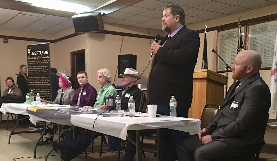 Mark Wicks, standing, addresses Montana Libertarians gathering for their party's nominating convention in Helena, Mont., on Saturday, March 11, 2017. Wicks will represent the Libertarian Party in the May 25 special election to fill the state's vacant congressional seat. The 46-year-old cattle rancher and writer from Inverness will be contending against Democrat Rob Quist and Republican Greg Gianforte, who unsuccessfully ran for governor last fall. (AP Photo/Bobby Caina Calvan)
