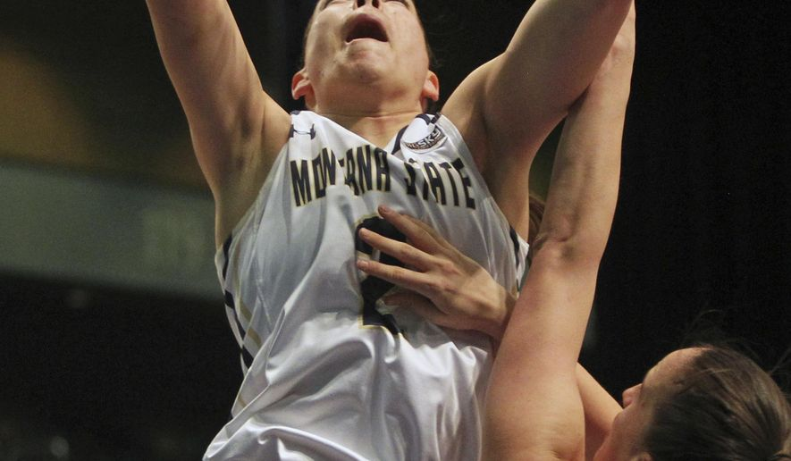 Montana State guard Peyton Ferris (2) shoots in front of Idaho State guard Isabel Vara de Rey (1) during the first half an NCAA college basketball game in the finals of the Big Sky tournament in Reno, Nev., Saturday, March 11, 2017. (AP Photo/Lance Iversen)