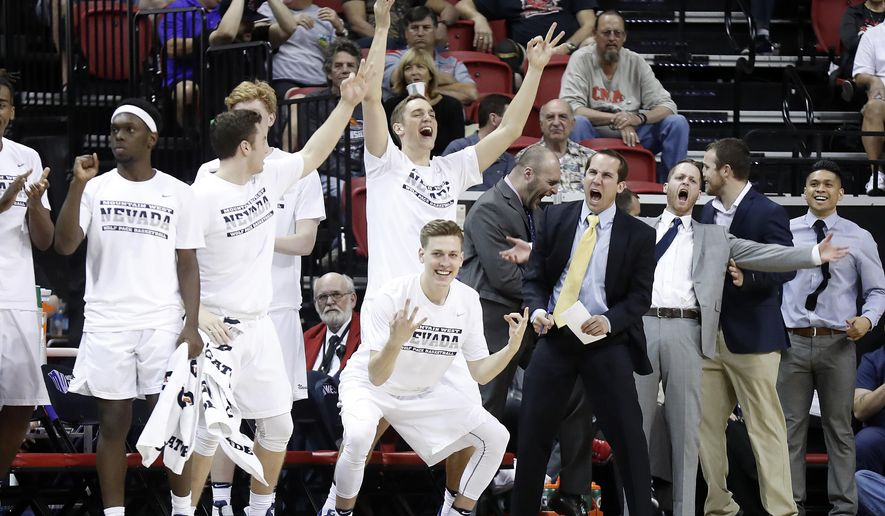 The Nevada bench reacts after a 3-point shot during the first half of an NCAA college basketball game against Colorado State for the Mountain West Conference tournament championship Saturday, March 11, 2017, in Las Vegas. (AP Photo/Isaac Brekken)