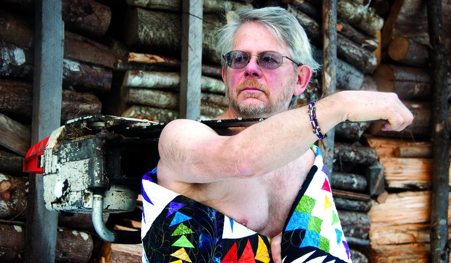 This Dec. 4, 2016, photo provided by Ruth Culp shows calendar model Vern Culp on Galankin Island in Sitka Sound, near Sitka, Alaska. He and 12 other Sitka-area men stripped and then strategical posed behind quilts for a calendar fundraiser on behalf of the Ocean Wave Quilt Guild in Sitka. (Photo by Ruth Culp via AP)