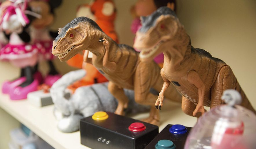 Remote controlled dinosaurs are among the modified toys in the tech tools library at Children's Respite Care Center Wednesday, Feb 22, 2017, in Omaha, Neb. (Rebecca Gratz/The World-Herald via AP)