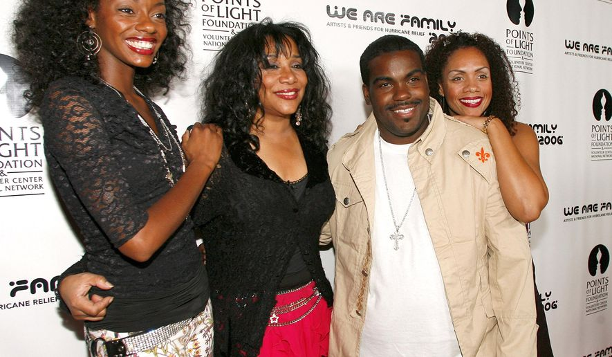 "File- This Aug. 14, 2006 file photo shows Joni Sledge, one of the original members of ""Sister Sledge,"" second from left, posing with Rodney Jerkins, second from right, her niece Camille Sledge, left, and her cousin Amber Sledge at the ""We Are Family 2006 - All-Star Katrina Benefit CD and Documentary DVD Launch"" in Century City, Calif. Sledge, who with her sisters recorded the defining dance anthem ""We Are Family,"" has died, the band's representative says. She was 60. Sledge was found dead in her home by a friend in Phoenix, Arizona, on Friday, the band's publicist, Biff Warren, said Saturday, March 11, 2017. A cause of death has not been determined.  (AP Photo/Chris Polk, File)"