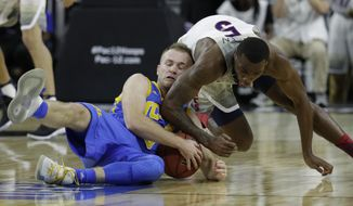 UCLA's Bryce Alford, left, and Arizona's Kadeem Allen scramble for the ball during the first half of an NCAA college basketball game in the semifinals of the Pac-12 men's tournament Friday, March 10, 2017, in Las Vegas. (AP Photo/John Locher)
