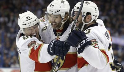 Florida Panthers right wing Jaromir Jagr (68) celebrates with center Jonathan Marchessault (81) and defenseman Keith Yandle (3) after scoring against the Tampa Bay Lightning during the first period of an NHL hockey game, Saturday, March 11, 2017, in Tampa, Fla. (AP Photo/Chris O'Meara)