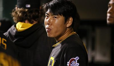 FILE - In this Sept. 26, 2016, file photo, Pittsburgh Pirates' Jung Ho Kang stands in the dugout during a baseball game against the Chicago Cubs in Pittsburgh. Kang was placed on the restricted list while he's delayed in South Korea by visa issues related to a recent DUI arrest. (AP Photo/Gene J. Puskar, File)