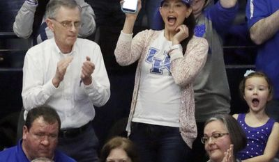 Actress and avid Kentucky fan Ashley Judd, center, shoots video as the crowd celebrates Kentucky's 79-74 win over Alabama in an NCAA college basketball game in the semifinals of the Southeastern Conference tournament Saturday, March 11, 2017, in Nashville, Tenn. (AP Photo/Mark Humphrey)