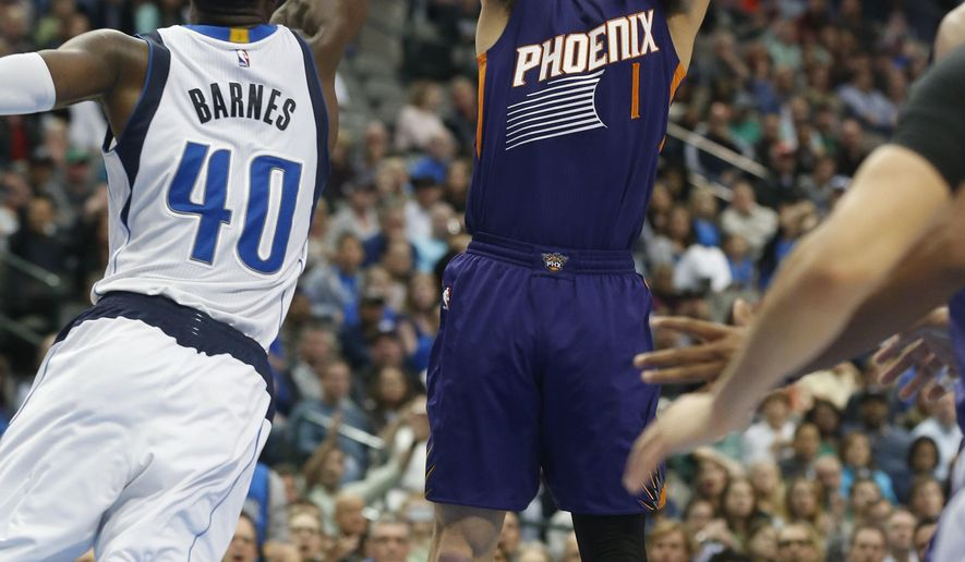 Phoenix Suns guard Devin Booker (1) shoots over Dallas Mavericks forward Harrison Barnes (40) during the second half of an NBA basketball game in Dallas, Saturday, March 11, 2017. (AP Photo/Michael Ainsworth)