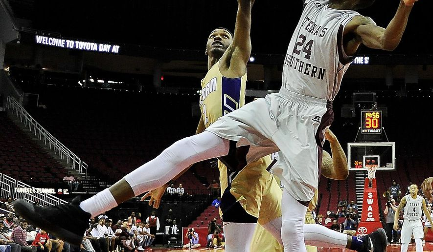 Texas Southern center Marvin Jones (24) and Alcorn State guard A.J. Mosby fight for a rebound during the first half of an NCAA college basketball game in the championship of the Southwestern Athletic Conference, Saturday, March 11, 2017, in Houston. (AP Photo/Eric Christian Smith)