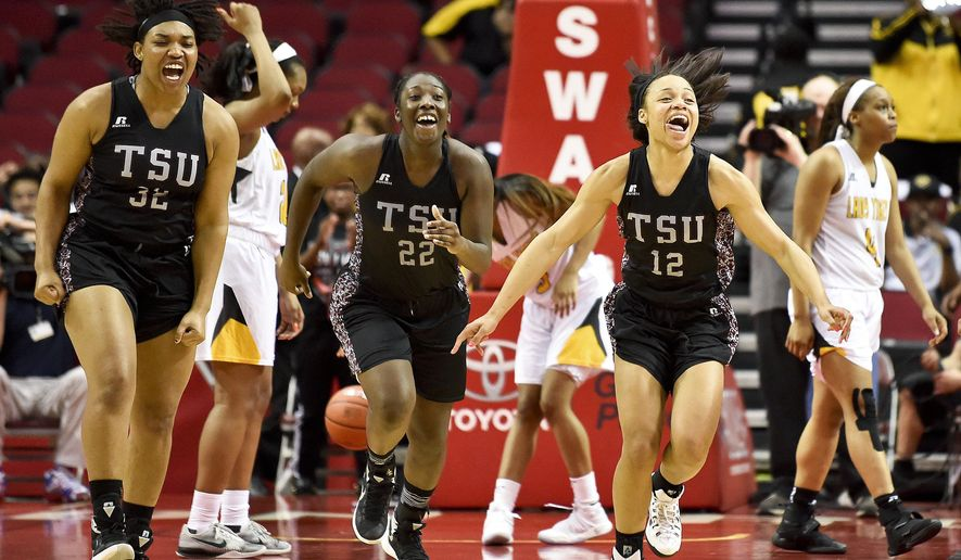 Texas Southern's Chynna Ewing (12), Breasia McElrath (22), and Nycolle Smith celebrate their 70-66 victory over Grambling as Grambling's Monisha Neal, right, walks off the court in an NCAA college basketball game in the championship of the Southwestern Athletic Conference, Saturday,  March 11, 2017, in Houston. (AP Photo/Eric Christian Smith)