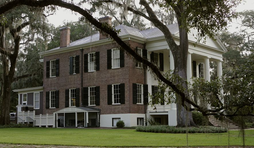 """File-This Aug. 29, 2013, file photo shows the Grove, a historical mansion that once belonged to former Florida Gov. LeRoy Collins in Tallahassee, Fla. Calling it a reflection of the """"larger American experience,"""" the home that has been witness to slavery, the Civil War and the civil rights era has been opened to the public in Tallahassee. State officials on Saturday, March 11, 2017, swung open the doors to the Grove, a state-owned mansion that was once the residence to Gov. LeRoy Collins. (AP Photo/Steve Cannon, File)"""