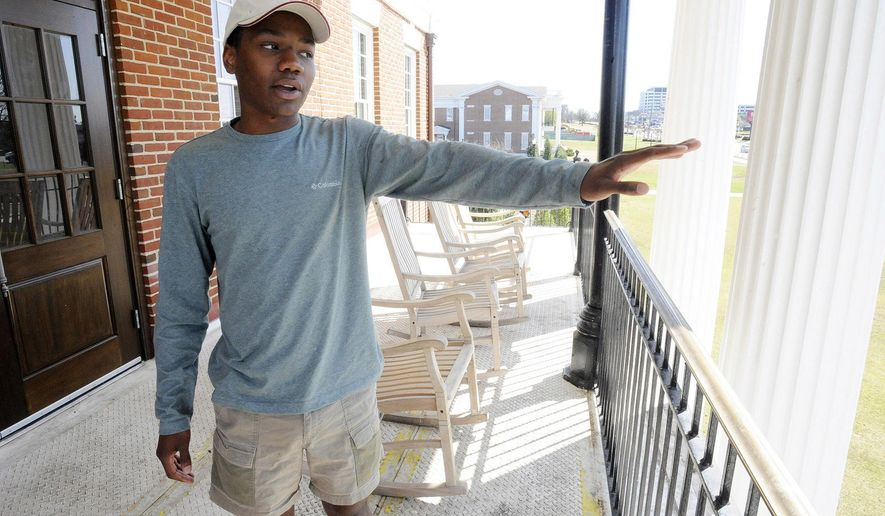 This photo taken Thursday, March 6, 2017, shows newly elected University of Alabama student body president Jared Hunter talking on the balcony of his Theta Chi fraternity house in Tuscaloosa, Ala. The 19-year-old Hunter is black but won a three-way race with the support of a secretive white-controlled campus organization called The Machine, which never before backed a black candidate running for president. (AP Photo/Jay Reeves)