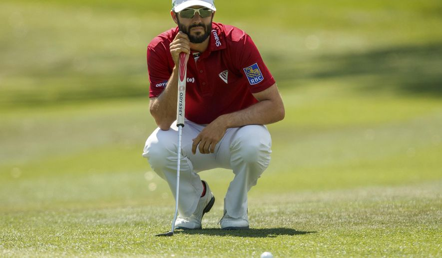 Adam Hedwin, of Canada, reads a putt on the 1st hole during the third round of the Valspar Championship golf tournament Saturday, March 11, 2017, at Innisbrook in Palm Harbor, Fla. (AP Photo/Mike Carlson)