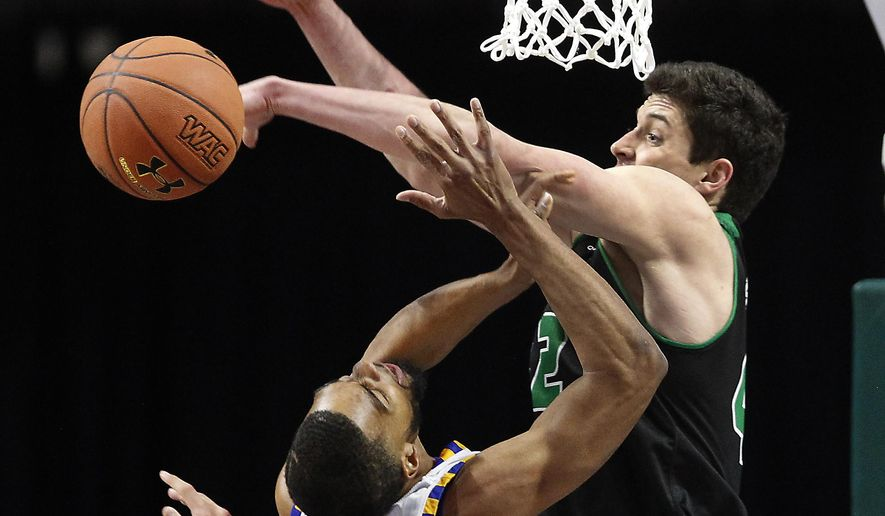 Cal State Bakersfield forward Jaylin Airington (11) has a shot rejected by Utah Valley center Andrew Bastien (42) during the first half of an NCAA college basketball game in the Western Athletic Conference tournament Friday, March 10, 2017, in Las Vegas. (AP Photo/L.E. Baskow)