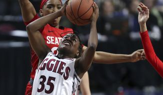 New Mexico State guard Moriah Mack (35) goes to the basket in front of Seattle guard Alexis Montgomery during the second half of NCAA college basketball game in the final of the Western Athletic Conference tournament Saturday, March 11, 2017, in Las Vegas. (AP Photo/L.E. Baskow)