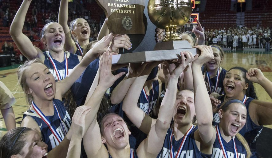 Appleton North raises their trophy after defeating De Pere 49-34 in the Division 1 final in the WIAA girls' state basketball championships Saturday, March 11, 2017 in Green Bay, Wis. (AP Photo/Mike Roemer)