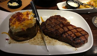 The Delmonico steak (foreground) offered as a spring special at Longhorn Steakhouse.  (Eric Althoff/The Washington Times)