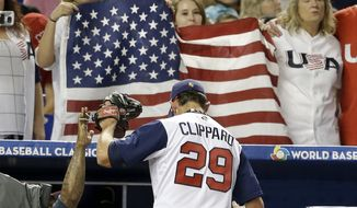 United States' Tyler Clippard enters the dugout after striking out the side in the seventh inning in a first-round game of the World Baseball Classic against Canada, Sunday, March 12, 2017, in Miami. The United States won 8-0. (AP Photo/Alan Diaz)