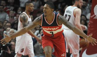 Washington Wizards guard Bradley Beal gestures after hitting a shot during the fourth quarter of the team's NBA basketball game against the Portland Trail Blazers in Portland, Ore., Saturday, March 11, 2017. The Wizards won in overtime, 125-124. (AP Photo/Steve Dykes)