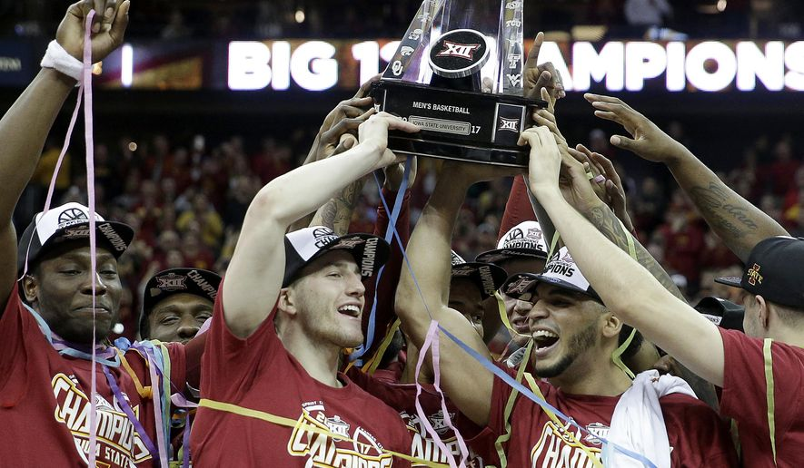 Iowa State players celebrate after beating West Virginia in an NCAA college basketball game to win the Big 12 tournament in Kansas City, Mo., Saturday, March 11, 2017. Iowa State won 80-74. (AP Photo/Charlie Riedel)