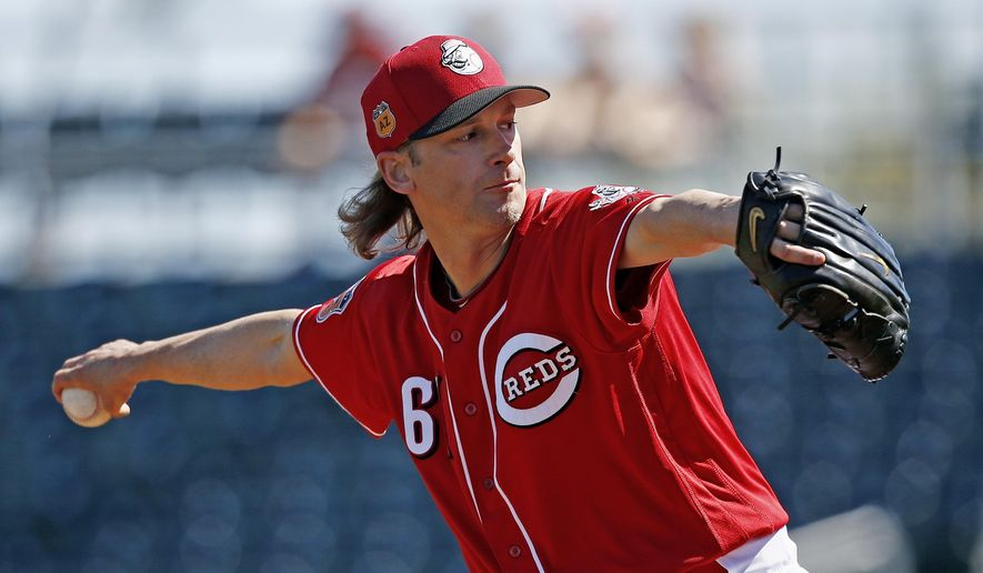 Cincinnati Reds starting pitcher Bronson Arroyo throws against the Milwaukee Brewers during the first inning of a spring training baseball game Sunday, March 12, 2017, in Goodyear, Ariz. (AP Photo/Ross D. Franklin)