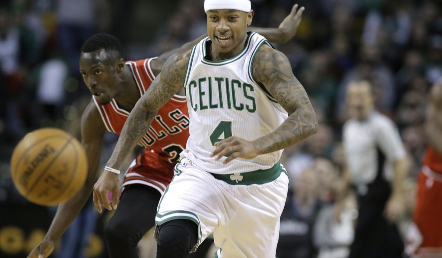 Boston Celtics guard Isaiah Thomas (4) and Chicago Bulls guard Jerian Grant (2) chase the ball in the first quarter of an NBA basketball game, Sunday, March 12, 2017, in Boston. The Celtics won 100-80. (AP Photo/Steven Senne)