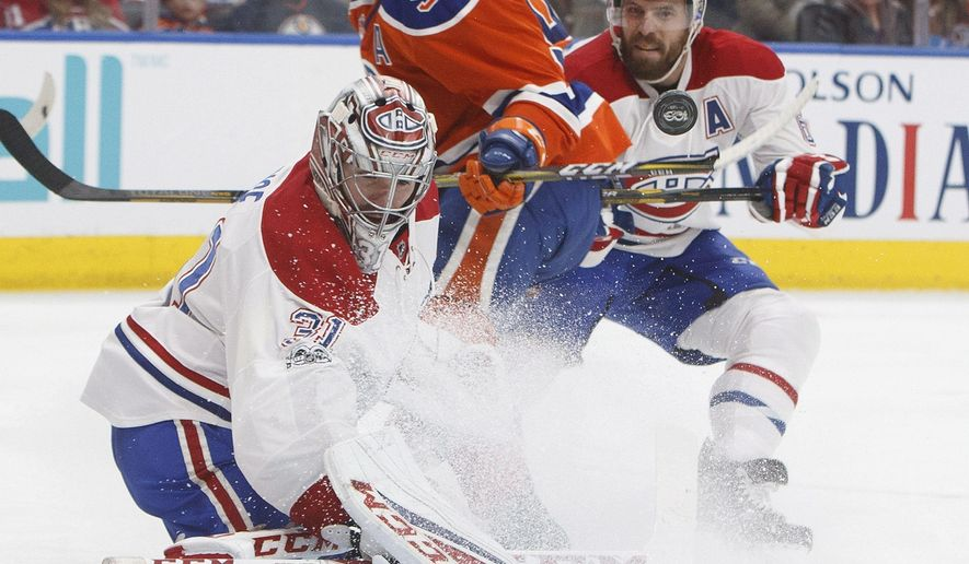 Montreal Canadiens goalie Carey Price (31) makes the save on Edmonton Oilers centre Ryan Nugent-Hopkins (93) as defenceman Shea Weber (6) defends during second period NHL hockey action in Edmonton, Alberta, Sunday March 12, 2017. (Jason Franson/The Canadian Press via AP)