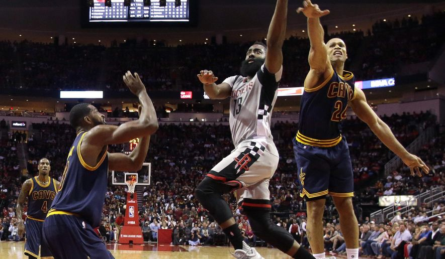 Houston Rockets' James Harden (13) goes up for a shot as Cleveland Cavaliers' Richard Jefferson (24) and Tristan Thompson, left, defend during the first quarter of an NBA basketball game Sunday, March 12, 2017, in Houston. (AP Photo/David J. Phillip)
