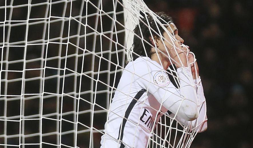 Paris Saint Germain's Edinson Cavani reacts after missing a goal during the French League One soccer match between Paris Saint Germain and Lorient, in Lorient, western France, Sunday, March 12, 2017. PSG won 2-1. (AP Photo/David Vincent)