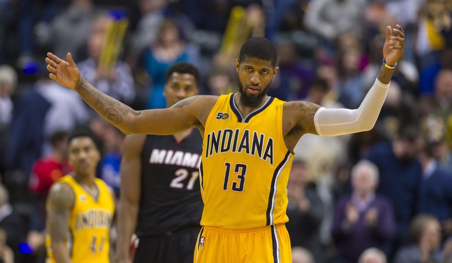 Indiana Pacers forward Paul George (13) reacts as time expires in the team's NBA basketball game against the Miami Heat on Sunday, March 12, 2017, in Indianapolis. The Pacers won 102-98. (AP Photo/Doug McSchooler)