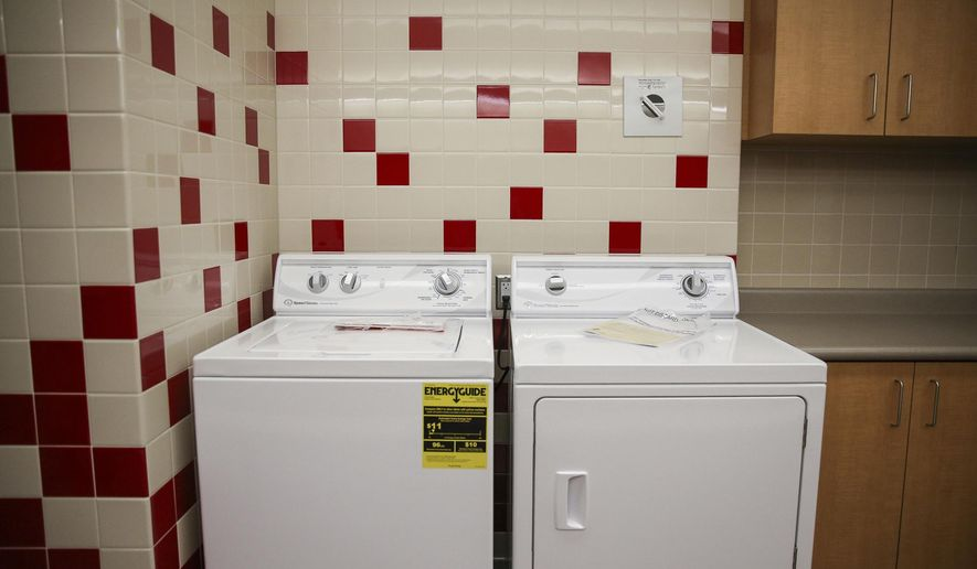 ADVANCE FOR USE SUNDAY, MARCH 12, 2017, AND THEREAFTER- In this March 10, 2017, photo, a wash rooms is shown at East High School in Salt Lake City. The school is transforming two small locker rooms into laundry/shower rooms for the school's homeless students in hopes of helping them with basic necessities so they can focus on learning, KSL-Radio reported. (Spenser Heaps/The Deseret News via AP)