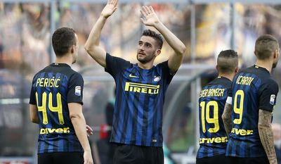 Inter Milan's Roberto Gagliardini, second from left, waves Atalanta's supporters after scoring during the Serie A soccer match between Inter Milan and Atalanta at the San Siro stadium in Milan, Italy, Sunday, March 12, 2017. (AP Photo/Antonio Calanni)