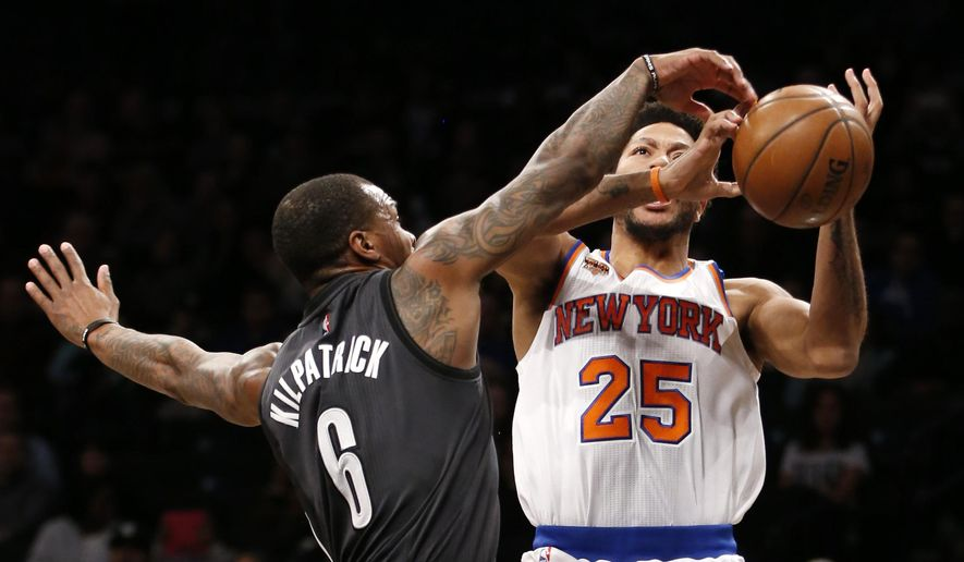 Brooklyn Nets guard Sean Kilpatrick (6) gets his hands on the ball as New York Knicks guard Derrick Rose (25) tries to position himself for a shot in the first half of an NBA basketball game, Sunday, March 12, 2017, in New York. (AP Photo/Kathy Willens)