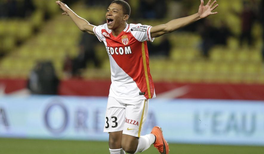FILE - In this Saturday, Feb. 20, 2016 file photo, Monaco's Kylian Mbappe Lottin celebrates scoring the third goal against Troyes during their French League One soccer match, in Monaco.  Les Monegasques will need top scorer Radamel Falcao and teen star Kylian Mbappe at their brilliant best to topple Manchester City in their return leg Champions League match. (AP Photo/Lionel Cironneau, File)
