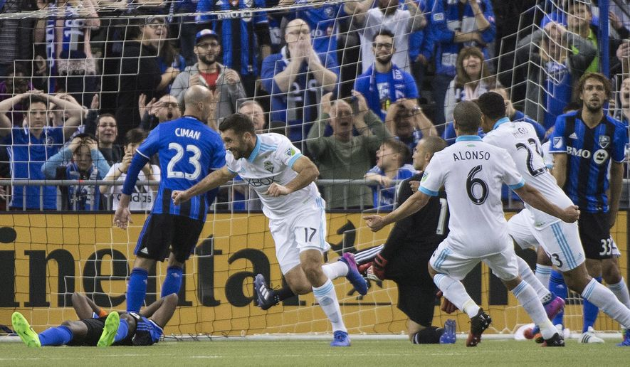 Seattle Sounders' Will Bruin (17) celebrates after scoring against the Montreal Impact during second-half MLS soccer game action in Montreal, Saturday, March 11, 2017. (Graham Hughes/The Canadian Press via AP)