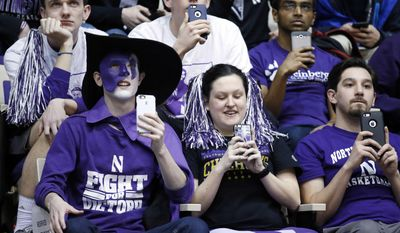 Northwestern fans attend the team's NCAA men's basketball tournament selection show watch party Sunday, March 12, 2017, in Evanston, Ill. (AP Photo/Nam Y. Huh)