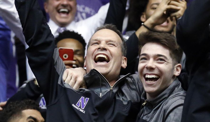 Northwestern head coach Chris Collins, center, guard/forward Sanjay Lumpkin, left, and guard Bryant McIntosh react during a NCAA Division I Men's Basketball Tournament Selection Show watch party, Sunday, March 12, 2017 at Welsh-Ryan Arena in Evanston, Illinois. This is the first time that Northwestern Men's Basketball team has been selected to play in the NCAA Tournament. Northwestern will play against Vanderbilt in the first round. (AP Photo/Nam Y. Huh)