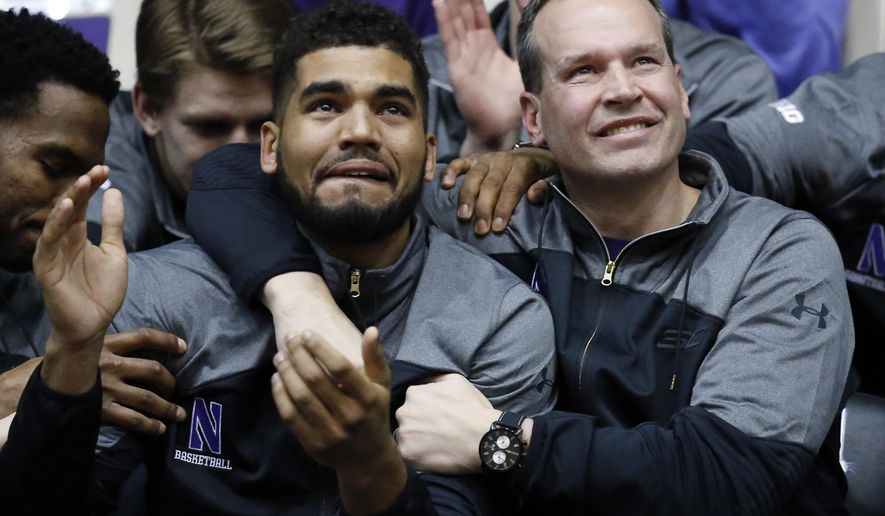 Northwestern coach Chris Collins, right, and guard/forward Sanjay Lumpkin react while watching television coverage of the NCAA men's basketball tournament selection show, Sunday, March 12, 2017 at Welsh-Ryan Arena in Evanston, Ill. Northwestern, in its first tournament appearance, will play Vanderbilt. (AP Photo/Nam Y. Huh)
