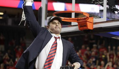 Arizona coach Sean Miller celebrates as he cuts down the net after Arizona defeated Oregon 83-80 in an NCAA college basketball game for the championship of the Pac-12 men's tournament Saturday, March 11, 2017, in Las Vegas.(AP Photo/John Locher)