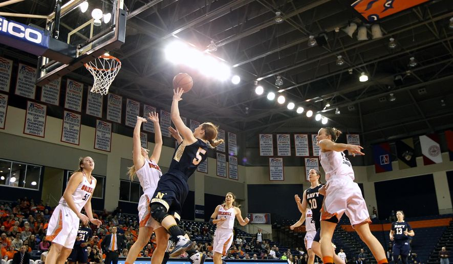 Navy's Sarita Condie (5) puts up a shot over Bucknell's Megan McGurk (11) during the first half of an NCAA college basketball Patriot League Championship game in Lewisburg, Pa., Sunday, March 12, 2017. (AP Photo/Chris Knight)