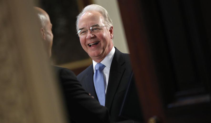 Health and Human Services Secretary Tom Price talks with a guest as they wait for the arrival of Vice President Mike Pence to begin a meeting with conservative groups to discuss healthcare, Friday, March 10, 2017, in the Indian Treaty Room of the Eisenhower Executive Office on the White House complex in Washington. (AP Photo/Pablo Martinez Monsivais)