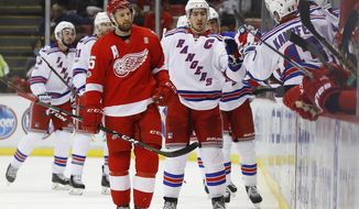 New York Rangers defenseman Ryan McDonagh (27) celebrates his goal as Detroit Red Wings defenseman Niklas Kronwall (55) skates to the bench in the second period of an NHL hockey game, Sunday, March 12, 2017, in Detroit. (AP Photo/Paul Sancya)