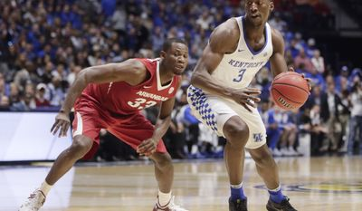 Kentucky forward Edrice Adebayo (3) drives against Arkansas forward Moses Kingsley (33) in the first half of an NCAA college basketball game for the championship of the Southeastern Conference tournament Sunday, March 12, 2017, in Nashville, Tenn. (AP Photo/Wade Payne)