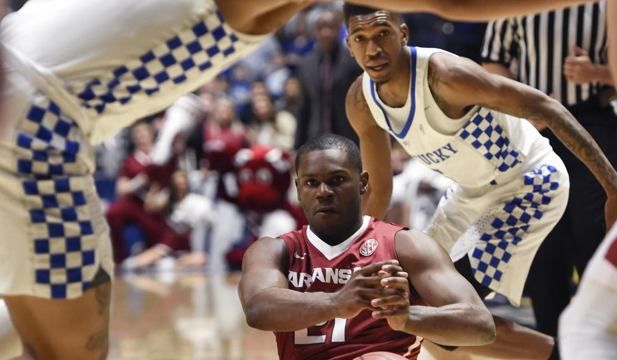 Arkansas guard Manuale Watkins (21) loses the ball between Kentucky's Isaiah Briscoe (13) and Malik Monk, right, in the first half of an NCAA college basketball game for the championship of the Southeastern Conference tournament Sunday, March 12, 2017, in Nashville, Tenn. (AP Photo/Sanford Myers)