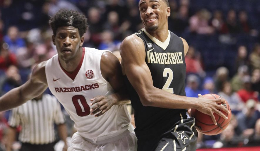 Vanderbilt guard Joe Toye (2) drives against Arkansas guard Jaylen Barford (0) in the second half of an NCAA college basketball game in the semifinals of the Southeastern Conference tournament Saturday, March 11, 2017, in Nashville, Tenn. Arkansas won 76-62. (AP Photo/Wade Payne)