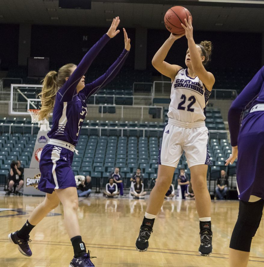 Central Arkansas' Maggie Proffitt (22) shoots a jump over Stephen F. Austin's Lovisa Brunnberg (5) in the first half of an NCAA college basketball game in the championship of the Southland Conference tournament, Sunday, March 12, 2017, in Katy, Texas. (AP Photo/Joe Buvid)