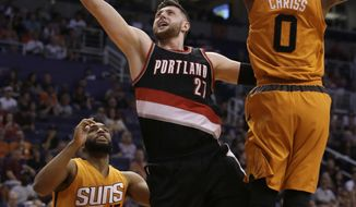 Portland Trail Blazers center Jusuf Nurkic (27) drives between Phoenix Suns' Alan Williams (15) and Marquese Chriss (0) during the first quarter of an NBA basketball game, Sunday, March 12, 2017, in Phoenix. (AP Photo/Rick Scuteri)