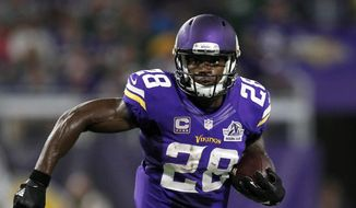 Minnesota Vikings running back Adrian Peterson carries the ball during the team's NFL football game against the Green Bay Packers in Minneapolis, in this Sept. 18, 2016, file photo. (AP Photo/Andy Clayton-King, File)